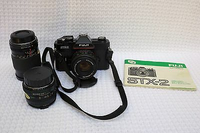 Fuji STX-2 film SLR camera, leather case, normal wide angle and telephoto lenses