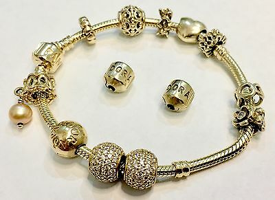 Authentic Solid 14ct yellow gold ALE Pandora bracelet and 11 charms  45.7g