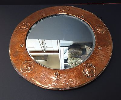Arts and Crafts Copper framed wall mirror.
