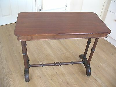 Old antique Victorian Mahogany console hall table on ceramic castors
