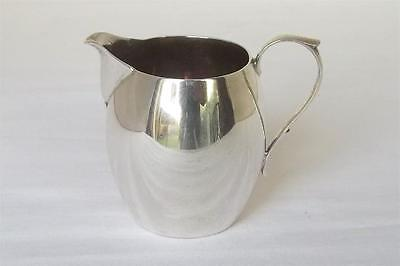 A Lovely Solid Sterling Silver Shaped Cream Jug London 1927.