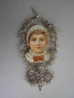 Antique Paper Children Head  In Tinsel Frame Christmas Ornament