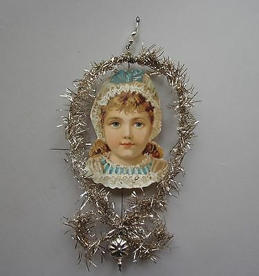 Antique Paper Girl Head In A Tinsel Frame Christmas Ornament