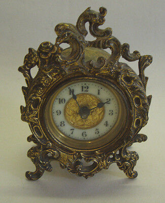 Antique gilt brass mantel clock made by THE BRITISH UNITED CLOCK Co LTD