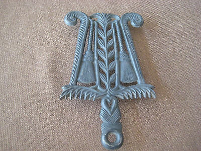 Cast Iron Trivet with 2 Brooms and Leaves Design