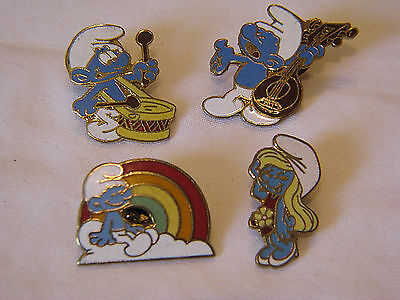 OLD LOT OF 4 DIFFERENT PINS - 80's PEYO SMURF