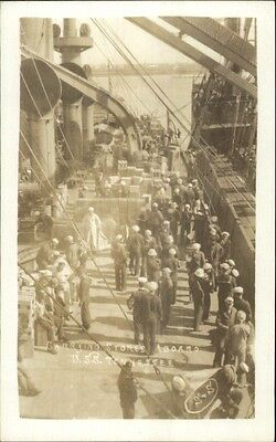 Sailors Carrying Stores Aboard USS Tennessee Naval Ship Real Photo Postcard