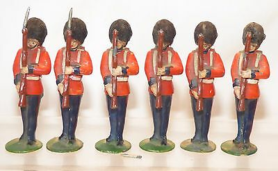 ML02 - 6 Timpo British Guardsmen with flock busbies