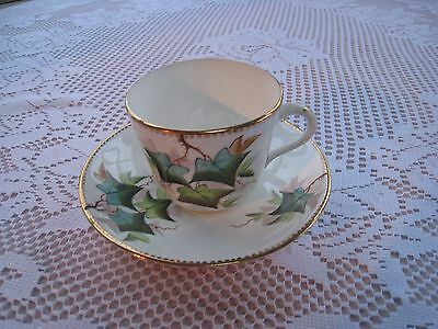 Unmarked  Cup And Saucer Decorated With Ivy Leaves And  With Gilt Edging
