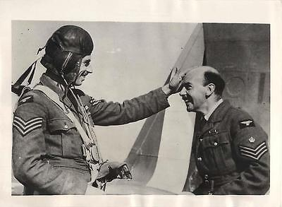WWII RAF Pilot Rubs Head of Flight Sergeant for Luck before Mission Press Photo
