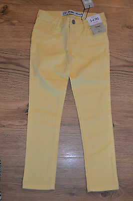 BNWT  Beautiful pair girls yellow cotton jeans.  Age 5-6