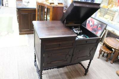 A 'DUOPHONE' Gramophone in Jacobean Cabinet with Barley Twist + 78's & Needles