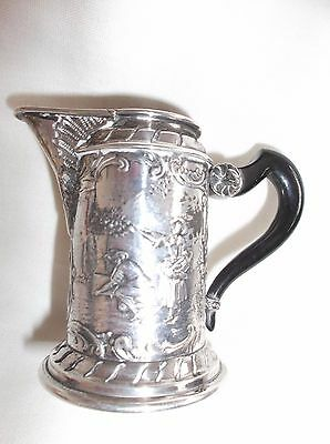 A Highly Decorated Continental Silver Cream Jug with Ebonised Handle