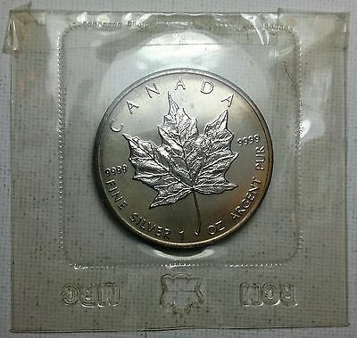1989 Canada 1 Troy Ounze Maple Leaf coin, 99.99 silver $5,  packaging damaged