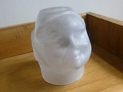 An Antique Frosted Glass Fairy Lamp Light Shade in form of a Monk's Head Face.
