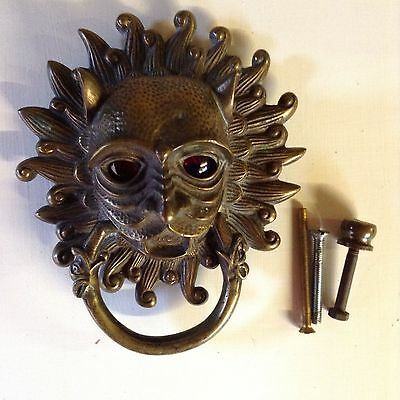 Victorian bronze door knocker with glass eyes.