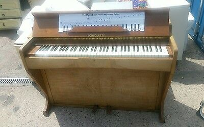 vintage consolette upright piano