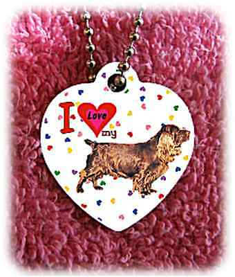 "Sussex Spaniel Dog heart necklace 24"" chain background of hearts"