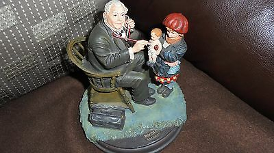the saturday evening post     norman rockwell    doctor and patient figurine
