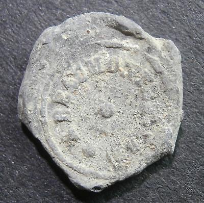 Lead seal - Edovard Vittich / A Beaumont - found in River Thames