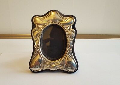 A Decrative Solid Silver Picture Frame  12.5cm by 9.5cm London 1989