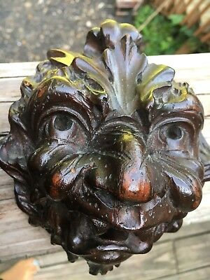 Pair of antique carved wood devil gargoyles jester Lions Faces
