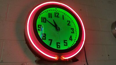 Neon clock. Electric Neon Clock Co. Cleveland Exposed ring. Advertising clock