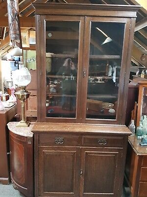 ANTIQUE, EARLY 20th c, SOLID OAK, GLAZED BOOKCASE ABOVE A TWO DRAWER CUPBOARD