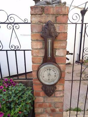 Late Victorian big barometer and thermometer mounted on a hand carved solid oak