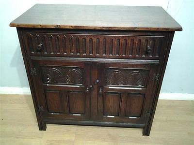 Priory style two  door carved oak  sideboard dresser base