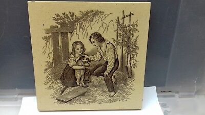 Antique mintons tile. china works. 6''  boy & girl with  dog