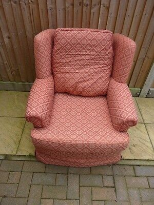 Red patterned arm chair, antique period style furniture.