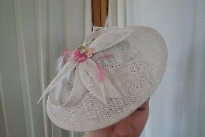 Unbranded bespoke  FASCINATOR in pearlly white. pink vintage buttons. NEW. VGC