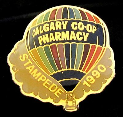 1990 CALGARY STAMPEDE HOT AIR BALLOON CO-OP PHARMACY SPONSOR Lapel Pin MINT