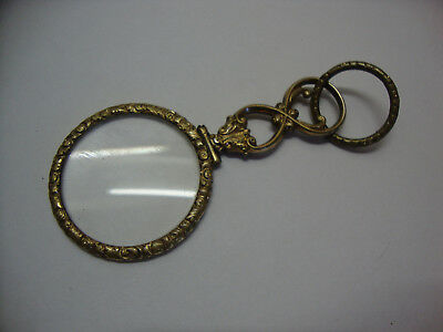 Antique rolled gold framed magnifying glass