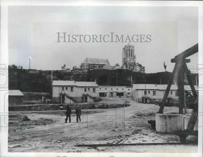 1950 Press Photo St Lo France neat new homes and store buildings on a rough road