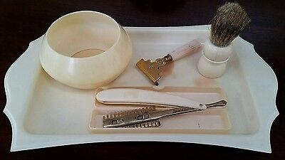 Vintage celluloid and plastic shaving set