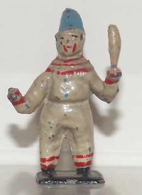 CL04 - Moultoy lead Clown with clubs figure. 56mm high