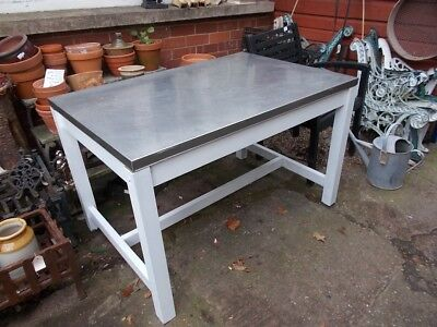 Large table with metal stainless steel top clean tidy smooth top.