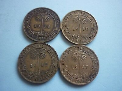 BRITISH WEST AFRICA - 4 x COLLECTABLE BRASS ONE SHILLING COINS - 1938,40,42,47