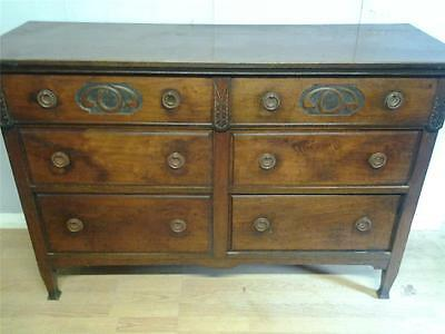 Arts and Crafts style carved red walnut chest of six drawers sideboard base