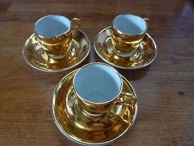 Royal Worcester set of 3 Coffee cups with saucers in gold and white.