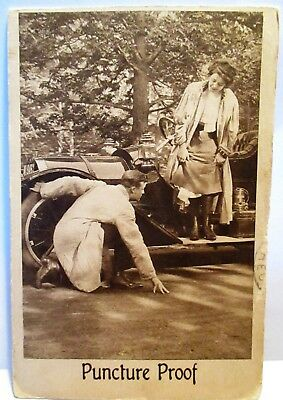 1910 Risque Postcard Puncture Proof - Man Kneeling By Car Looking At Ladys Legs