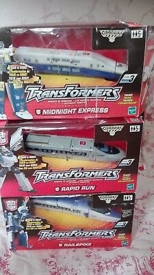 transformers (rapid run+railspike+midnight express) .hasbro TBE in boxes
