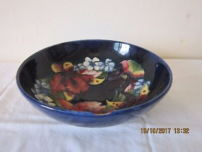Signed Moorcroft footed bowl with orchid pattern - cobalt blue / hand painted