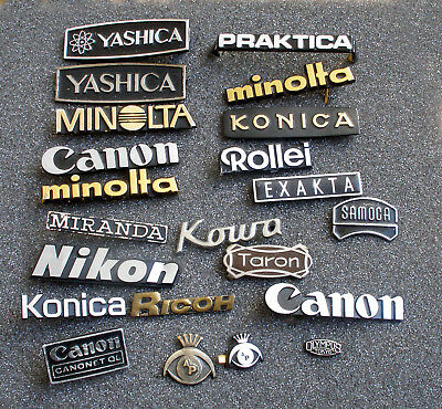 A Collection Of Camera Badges.