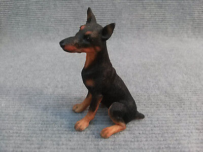 "Doberman Pinscher puppy ""Country Artists"" cast resin figurine."