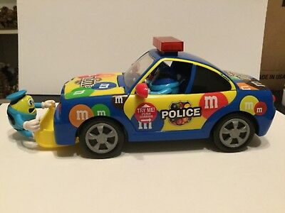 Very cute M&M candies police car with lights and sound, candy dispenser
