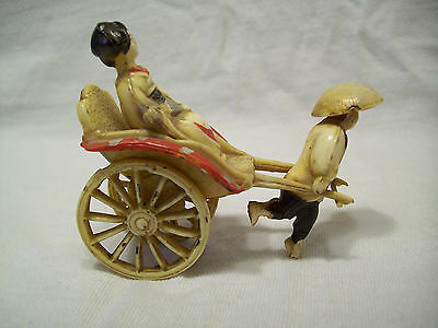 Celluloid Oriental Man Pulling Rickshaw With Lady In It