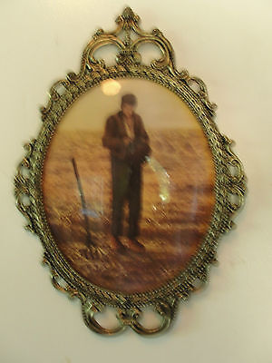 Decorative metal frame, oval, old, farmer out in field working ornate glass